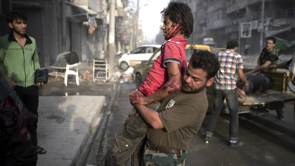 A fighter injured in the Arqub neighborhood of northern city of Aleppo is brought to a hospital on October 1, 2012, as fighting in Syria