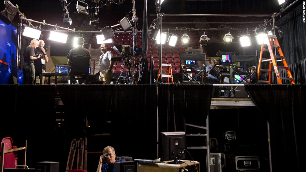 Workers prepare the set for the television anchors during the first presidential debate at the University of Denver on Monday, October 1.