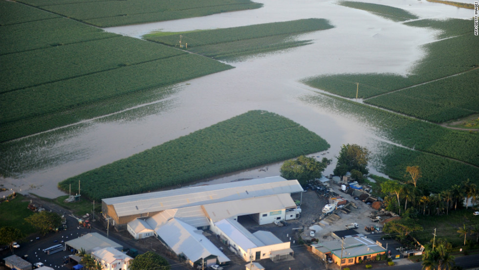 Sugar cane fields are seen submerged near Bundaberg in Queensland on December 30, 2010 after entire towns were inundated by the worst deluges in decades.
