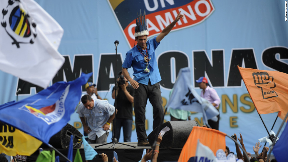 Capriles wears a native decoration from a shaman during a campaign rally in Puerto Ayacucho on Monday, October 1. Chavez's opponents are confident that on Sunday, Capriles will unseat the long-ruling leftist leader, a refrain previously heard before eventual defeats.