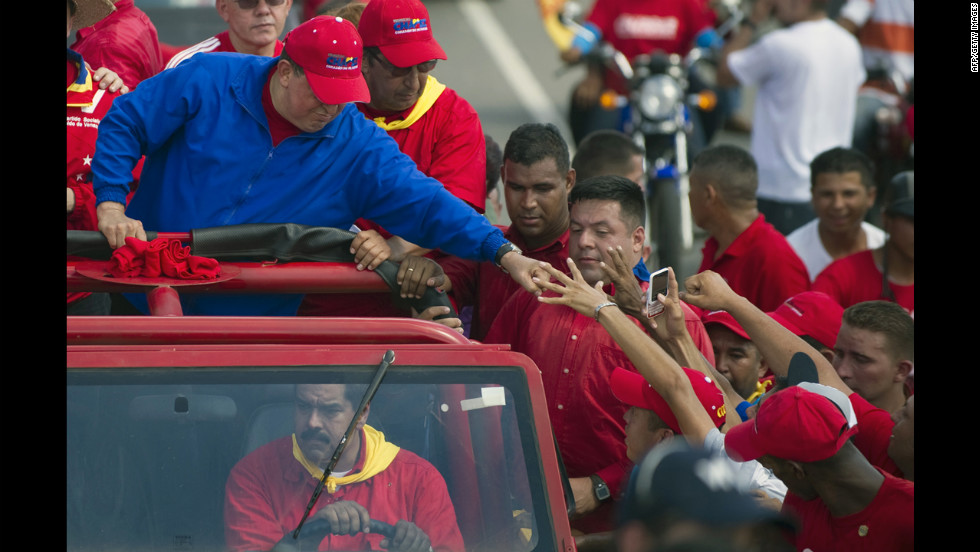 "Chavez greets supporters during a campaign rally in Sabaneta on Monday. He dismissed his much younger challenger as a ""fly"" not worth chasing when challenged to a debate this year."