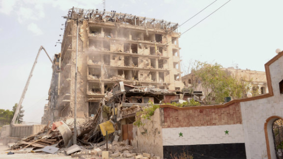 Three car bombs destroyed the area around a military officers