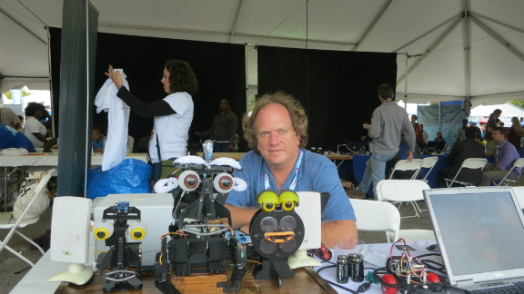 Brian Patton from Trenton, New Jersey brought a singing robot to the recent Maker Faire in New York. With eyebrows made from pipe cleaners and eye's borrowed from a doll, the robot is synched to a computer program that Patton devised and allows him to control facial expressions.