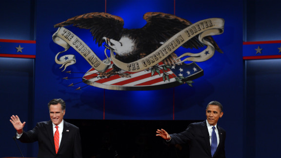 Romney and Obama wave to the crowd at the start of the presidential debate.
