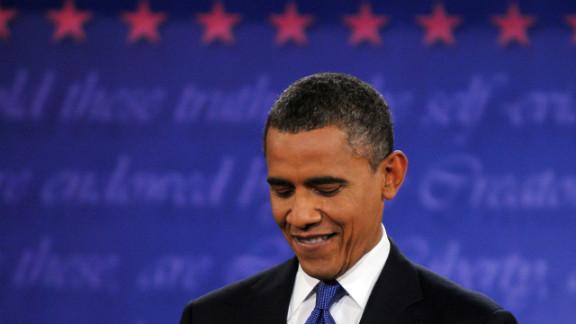 Obama listens during the debate in Denver.