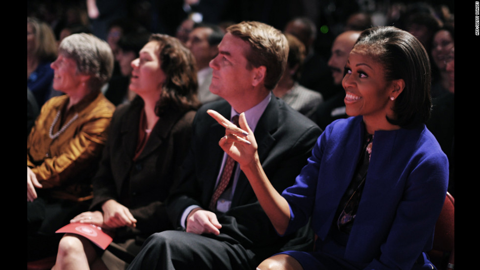 Michelle Obama points to Lehrer before the start of the debate.