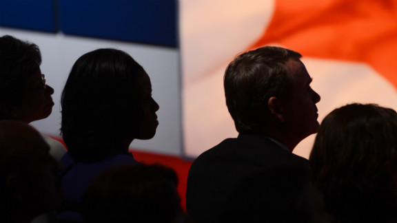 Michelle Obama listens to the debate.