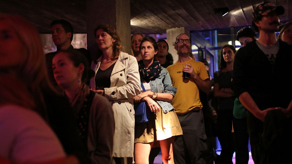 People watch the debate at Galapagos Art Space in Brooklyn, New York.