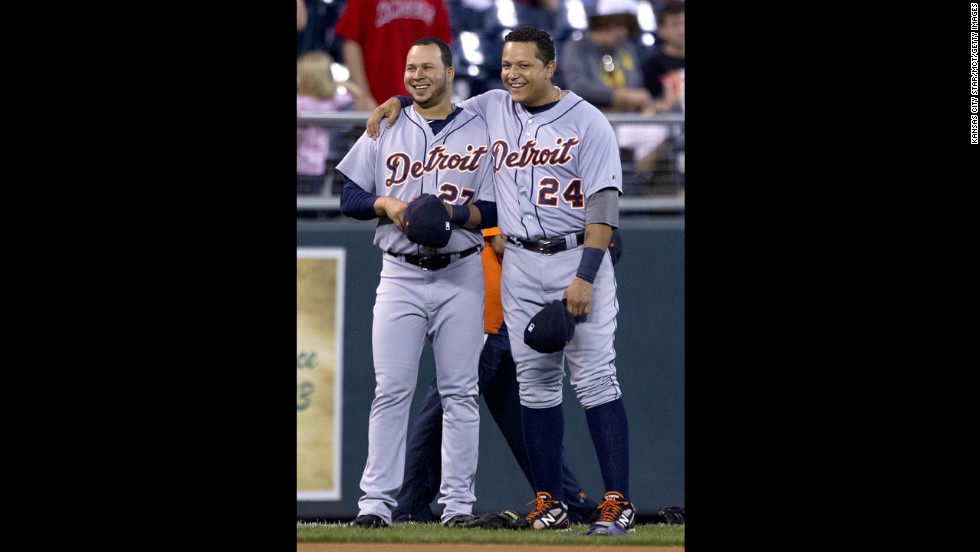 Cabrera and teammate Jhonny Peralta pal around before the start of play.