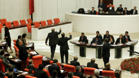 Members of parliament attend an emergency session to discuss a bill authorizing the Turkish military to launch cross-border operations in Ankara on Thursday.