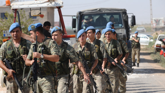 Turkish soldiers march in Akcakale on Thursday.