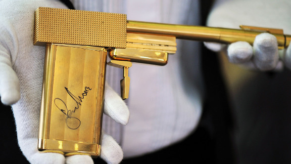 "A replica gun from the 1974 James Bond movie, ""The Man with the Golden Gun,"" autographed by Roger Moore."