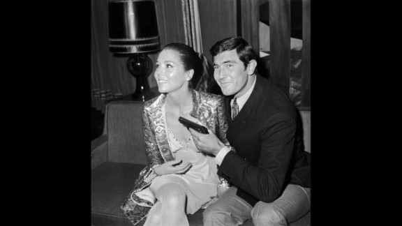 "George Lazenby with actress Diana Rigg, who played Teresa di Vicenzo, during a press conference for  ""On Her Majesty"
