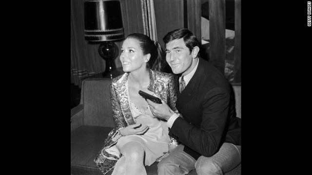 """George Lazenby, who played James Bond, and Rigg, who played Teresa di Vicenzo, during a news conference for """"On Her Majesty's Secret Service"""" in London, in October 1968."""