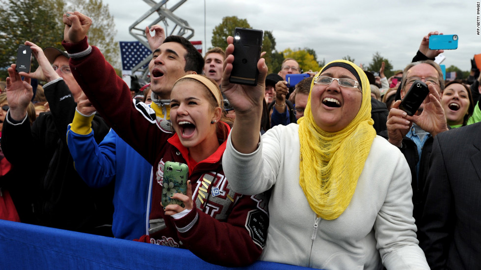 Audience members cheer as Obama makes his way onto the stage at Sloan's Lake Park in Denver on Thursday.