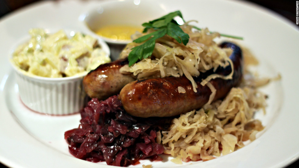 Chef Rob Burmeister describes his menu as American fusion, but likes to spice it up with themed specials. Here, he serves bratwurst with sauerkraut, sweet and sour red cabbage and potato salad for Oktoberfest.