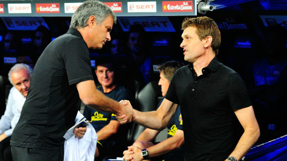 Real Madrid manager Jose Mourinho (left) and Barcelona manager Tito Vilanova (right) shake hands at the derby between the two clubs. Real