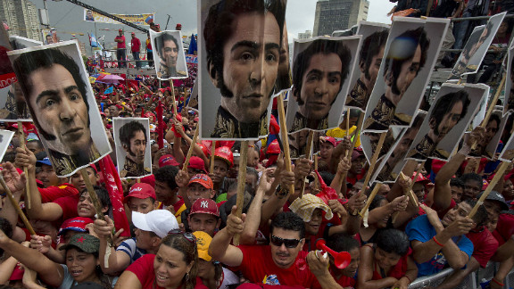 Chavez supporters hold photos of Simon Bolivar, who led Venezuela's fight for independence from Spain in the 1820s, during Chavez's campaign wrap-up rally in Caracas on Thursday, October 4.