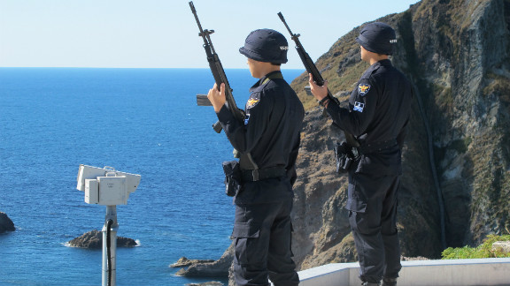 """South Korean police watch over the rocky outcrop located between the Korean peninsula and Japan. The head of the Dokdo guards, Lee Gwang-seup says, """"Japan wants to take our land by force. This has been our land since ancient times and we have to protect it."""" Japan calls the islands Takeshima."""