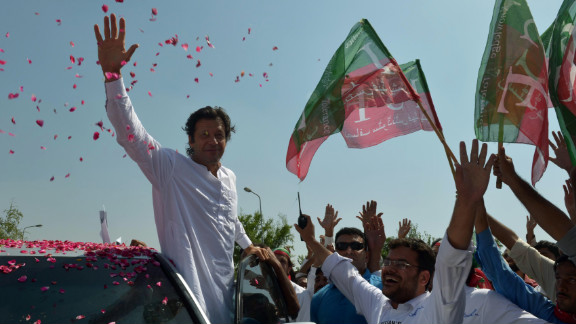 Imran Khan, a cricketer turned politician, waves to supporters at the start of a rally Saturday on the outskirts of Islamabad.