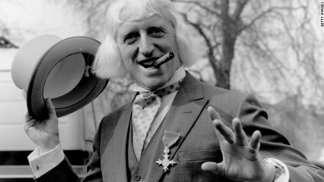 Jimmy Savile sports his Order of the British Empire medal after his 1972 investiture at Buckingham Palace in London.