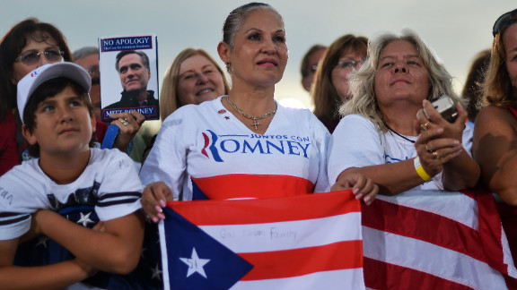 Romney supporters listen during Friday