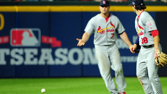 St. Louis Cardinals players Matt Holliday, left, and Pete Kozma react after the ball hits the grass as the infield fly rule is called in the eighth inning on a ball hit by Andrelton Simmons of the Atlanta Braves on Friday, October 5.
