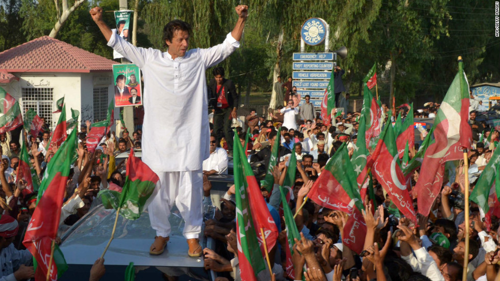 Pakistan cricket star turned politician Imran Khan gestures as he stands on a vehicle during a rally in Mianwali, northern Pakistan, on October 6, 2012.