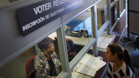 MIAMI, FL - OCTOBER 01: Dorothy Torrence (L), from the Miami-Dade Elections Department, helps Viviana Camacho with information about her voter registration on October 1, 2012 in Miami, Florida. With the October ninth deadline for people to register to vote in the upcoming election approaching, the Florida Department of State says the number of people registering to vote is now averaging between 1,500 and 3,000 a day. Democrats have been questioning the motives of the Republican led legislator