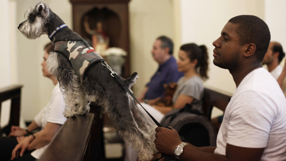 A man and his dog wait for the blessing at Sao Francisco de Assis Church in Sao Paulo, Brazil, on Thursday, October 4.