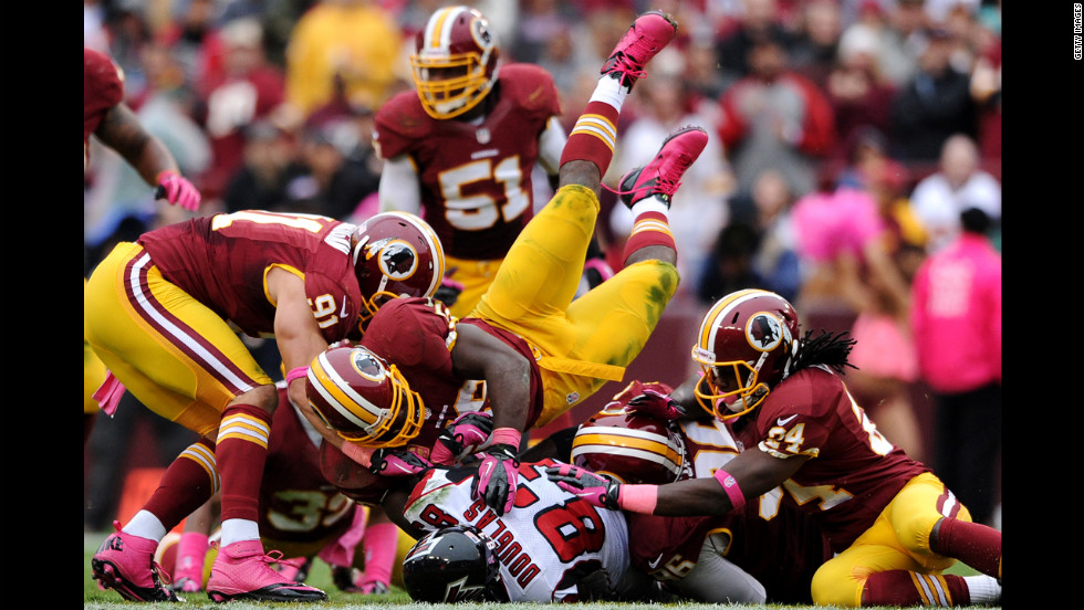 Harry Douglas of the Atlanta Falcons is hit by multiple Washington Redskins defenders.