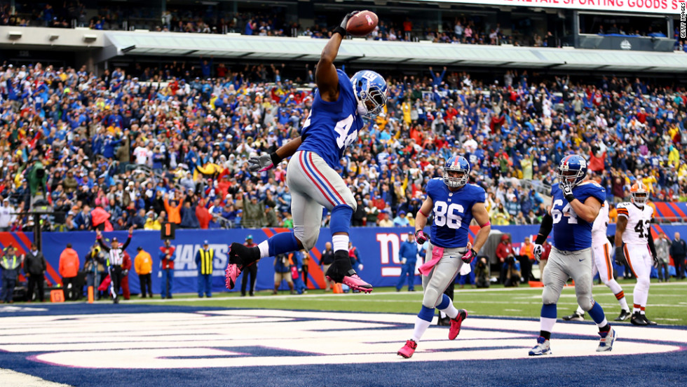 Ahmad Bradshaw of the Giants celebrates a touchdown against the Browns.