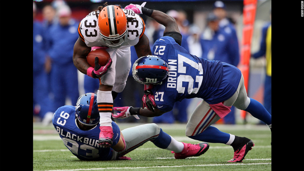 Chase Blackburn and Stevie Brown of the New York Giants tackle Trent Richardson of the Cleveland Browns on Sunday at MetLife Stadium in East Rutherford, New Jersey.