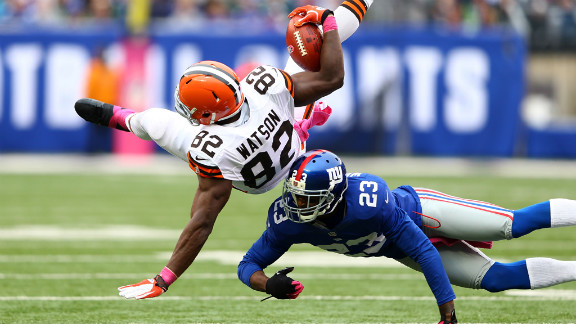 Corey Webster of the New York Giants tackles Benjamin Watson of the Cleveland Browns on Sunday.
