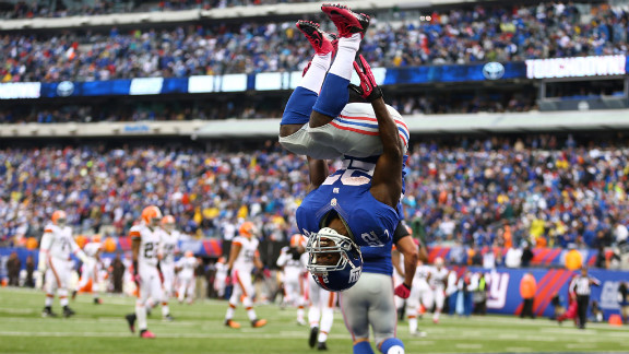 David Wilson of the New York Giants celebrates a touchdown on Sunday by doing a back flip.