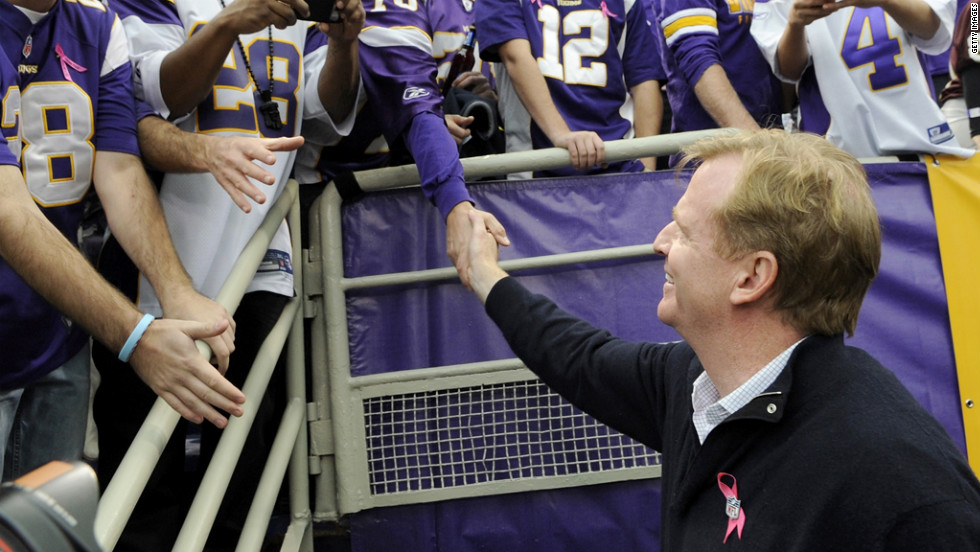 NFL Commissioner Roger Goodell greets fans before Sunday's Vikings-Titans game in Minneapolis.