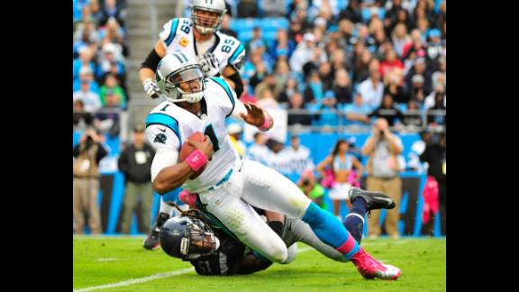Bruce Irvin of the Seahawks sacks Panthers quarterback Cam Newton.