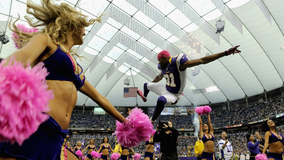 Jerome Simpson of the Minnesota Vikings jumps as he is announced before Sunday