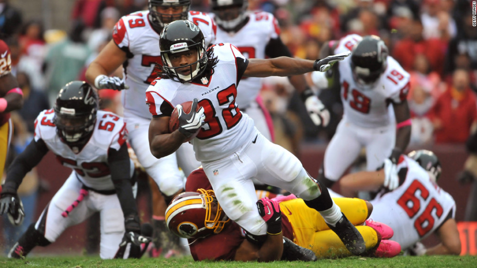 Michael Turner of the Atlanta Falcons runs the ball against the Washington Redskins on Sunday at FedEx Field in Landover, Maryland.