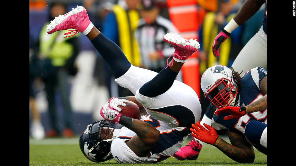Willis McGahee of the Denver Broncos is stopped by Brandon Spikes of the New England Patriots.