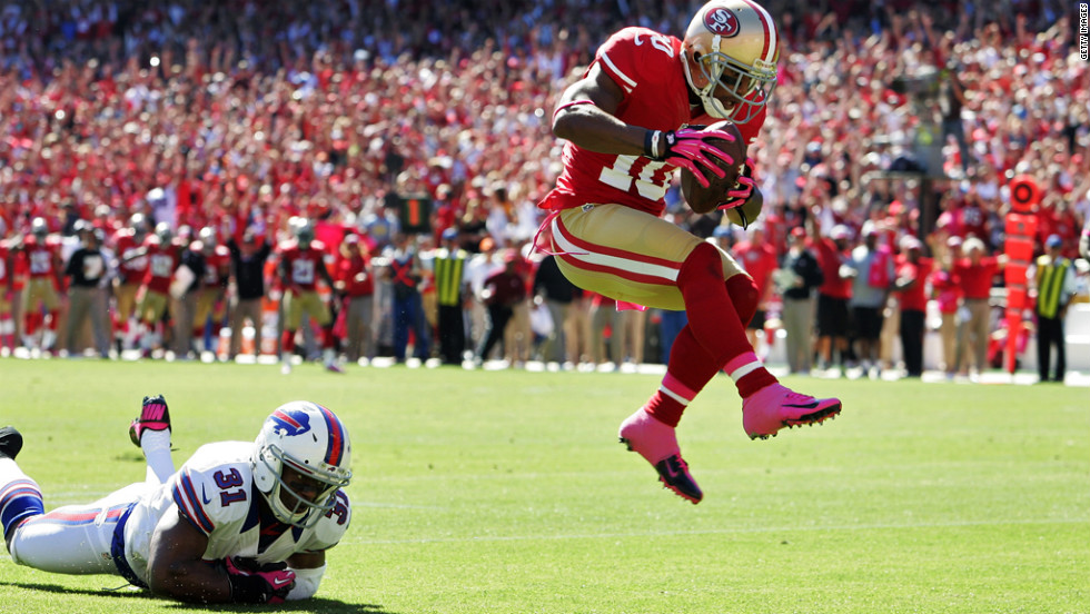 Kyle Williams of the San Francisco 49ers leaps into the end zone for a touchdown.