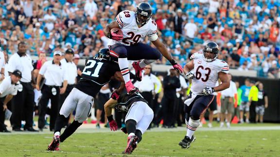 Michael Bush of the Chicago Bears jumps over Chris Prosinski of the Jacksonville Jaguars.
