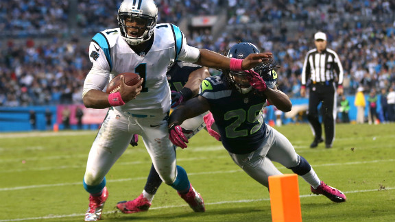 Earl Thomas of the Seattle Seahawks stops Carolina Panthers quarterback Cam Newton from getting into the end zone late in the fourth quarter on Sunday at Bank of America Stadium in Charlotte, North Carolina.