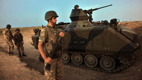 Turkish soldiers stand guard in Akcakale on Thursday, October 4. The stray shelling along the border has prompted Turkey to respond with threats and weapons fire, fueling concerns the Syrian civil war will bleed into a greater regional battle.