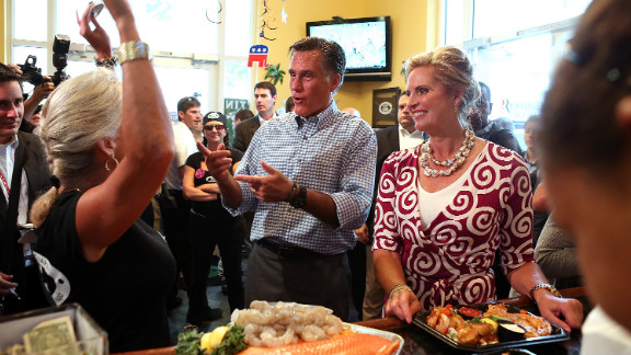 Republican presidential candidate Mitt Romney and his wife, Ann, greet workers at the Tin Fish restaurant following a rally Sunday in Port St. Lucie, Florida.