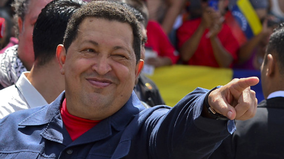 Chavez greets a crowd before voting Sunday. The 58-year-old leader has been weakened by two surgeries for cancer, keeping secret the type of cancer and his prognosis. Photos: Venezuela's presidential vote