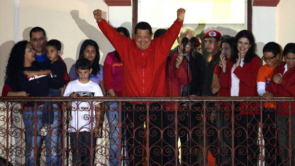 Venezuelan President Hugo Chavez greets supporters after receiving news of his re-election in Caracas on Sunday, October 7. With 90% of the ballots counted, Chavez, who has been president since 1999, defeated Henrique Capriles Radonski with 54.42% of the votes, according to an National Electoral Council official. Photos: Venezuela's presidential vote