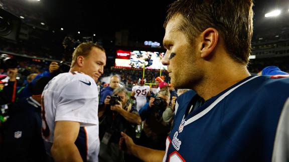 Patriots quarterback Tom Brady greets Broncos quarterback Peyton Manning midfield following Sunday
