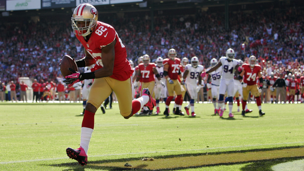 "Mario Manningham of the San Francisco 49ers pulls off a touchdown against the Buffalo Bills in the fourth quarter on Sunday at Candlestick Park in San Francisco. Check out the action so far from Week Five of the NFL, or <a href=""http://www/2012/09/27/worldsport/gallery/nfl-week-4/index.html"" target=""_blank""><strong>look back at the best from Week Four</strong></a>."