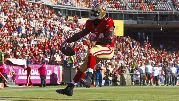 Anthony Dixon of the 49ers scores a touchdown Sunday.